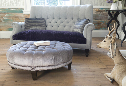 John Sankey Holkham Sofa in Milligan Silver and Du Barry Velvet Iris with Boothby Round Ottoman in Ibsen Velvet Violet Grey